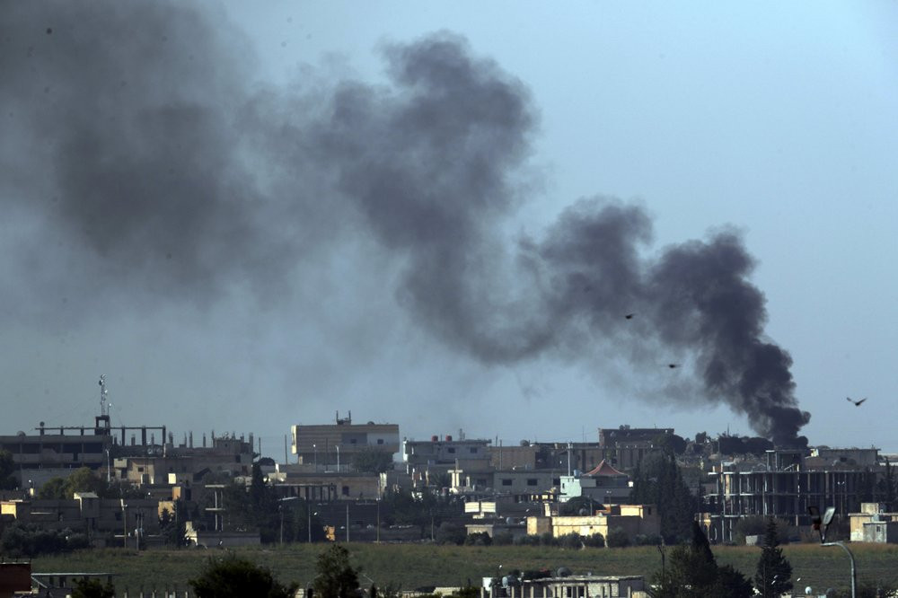 In this photo taken from the Turkish side of the border between Turkey and Syria, in Akcakale, Sanliurfa province, southeastern Turkey, smoke billows from targets in Tel Abyad, Syria, during bombardment by Turkish forces, Friday, Oct. 11, 2019.