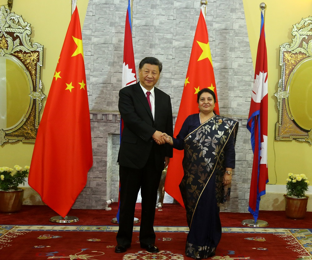 President Bidya Devi Bhandari welcomes her Chinese counterpart Xi Jinping at the former's office in Shhetal Niwas Saturday evening.