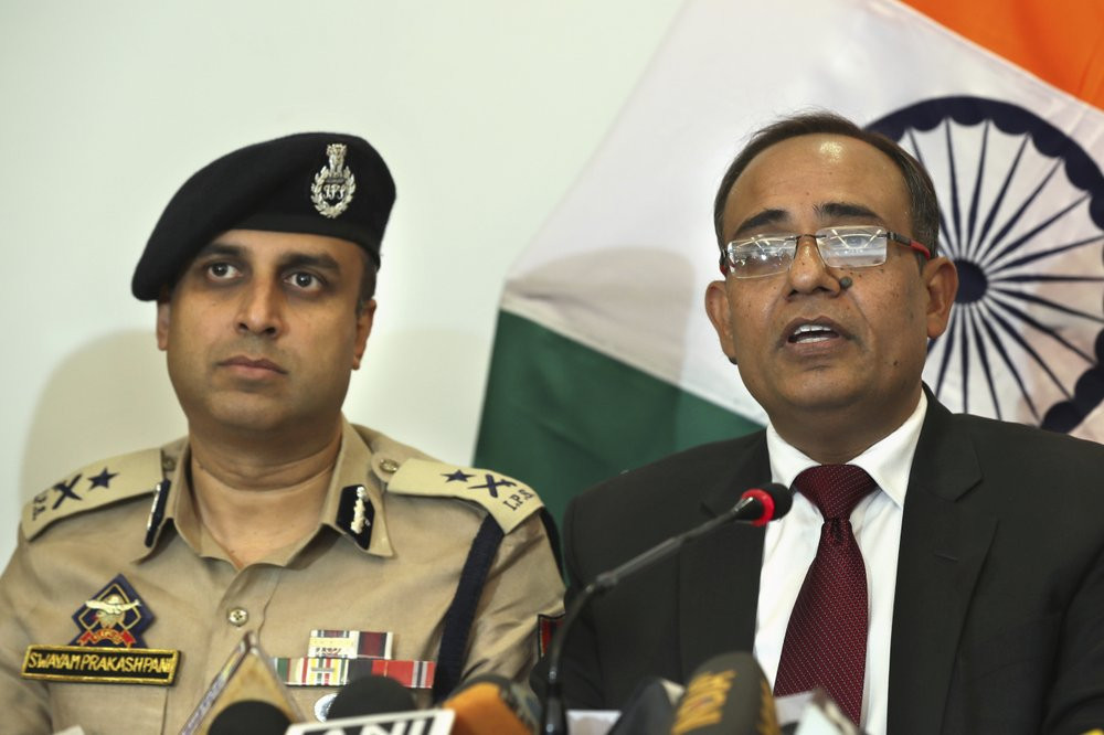 Government spokesperson Rohit Kansal, right, speaks as Swayam Prakash Pani, Inspector General of Kashmir Police sits beside him in Srinagar, Kashmir on Saturday.