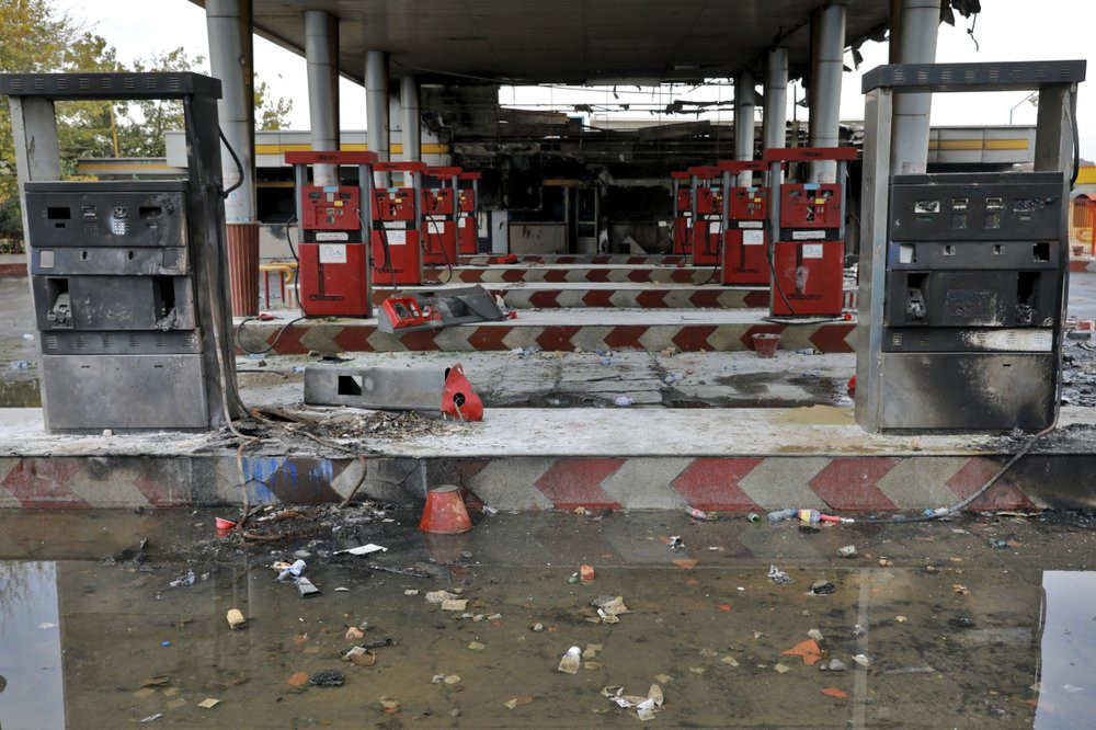 In this Nov. 20, 2019, file photo, rainwater pools at a gas station attacked during protests over government-set gasoline prices in Tehran, Iran.
