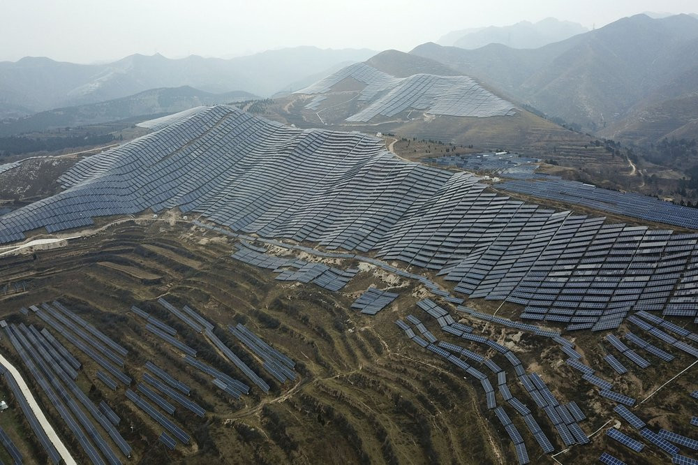 In this Nov. 27, 2019, photo, a solar panel installation is seen in Ruicheng County in central China's Shanxi Province.