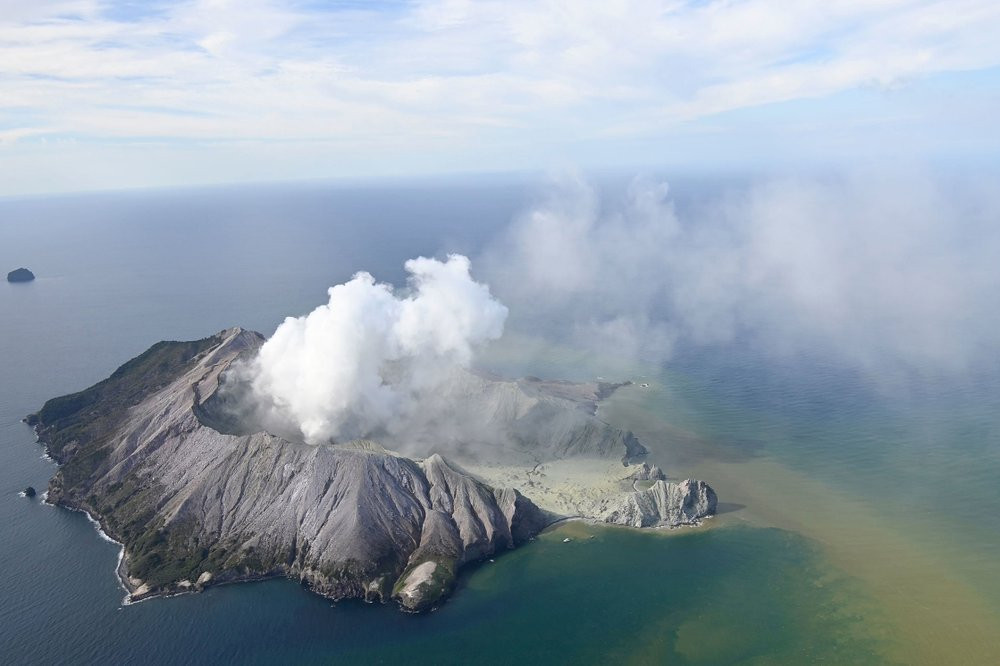 This aerial photo shows White Island after its volcanic eruption in New Zealand Monday, Dec. 9, 2019. The volcano on a small New Zealand island frequented by tourists erupted Monday, and a number of people were missing and injured after the blast.
