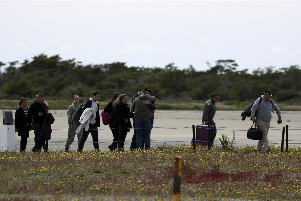 Relatives of passengers of a missing military plane arrive to an airbase in Punta Arenas, Chile, Wednesday, Dec. 11, 2019.