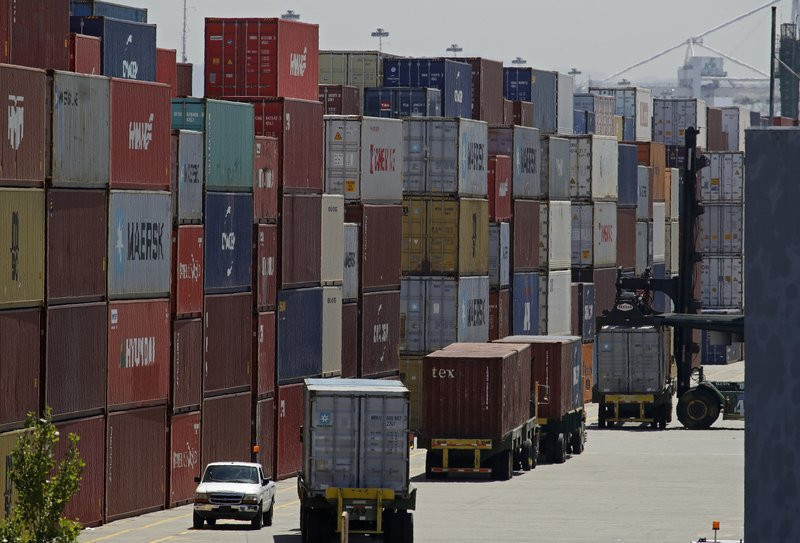 In this July 22, 2019, file stacked containers wait to be loaded on to trucks at the Port of Oakland in Oakland, California.
