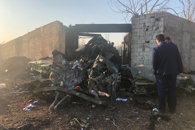 Debris is seen from a plane crash on the outskirts of Tehran, Iran, Wednesday, Jan. 8, 2019. A Ukrainian airplane carrying at least 170 people crashed on Wednesday shortly after takeoff from Tehran's main airport, killing all onboard, state TV reported.
