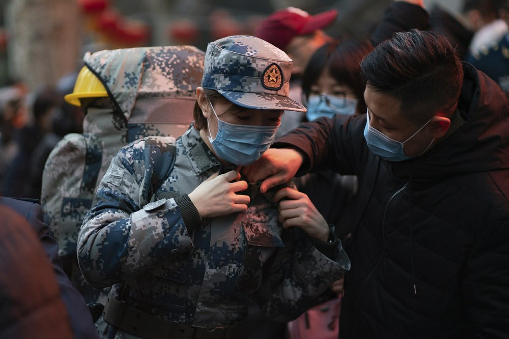 In this photo taken Jan 24, 2020 and released by Xinhua News Agency, a military medic from the Air Force Medical University prepares to leave for Wuhan from Xi'an, capital of northwestern China's Shaanxi Province.