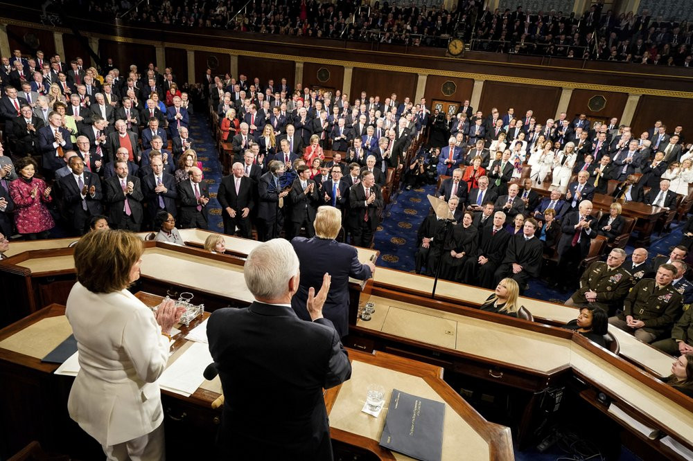 President Donald Trump delivers his State of the Union address to a joint session of Congress on Capitol Hill in Washington, Tuesday, Feb. 4, 2020, as House Speaker Nancy Pelosi of Calif., left, and Vice President Mike Pence watch.
