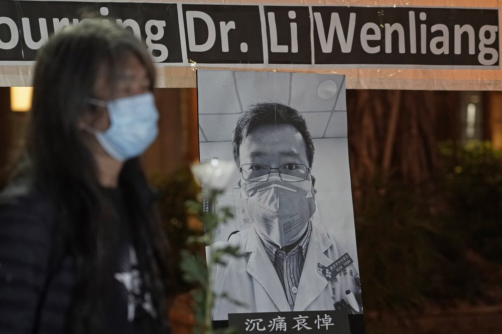 Pro-democracy activist Leung Kwok-hung, wearing a mask, attends a vigil for Chinese doctor Li Wenliang, in Hong Kong, Friday, Feb. 7, 2020.