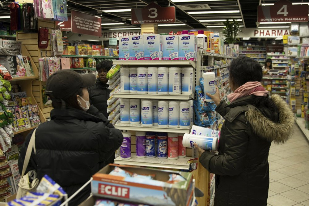 Customers look at sanitizing wipes on the shelves of a pharmacy in New York on Wednesday, March 4, 2020.