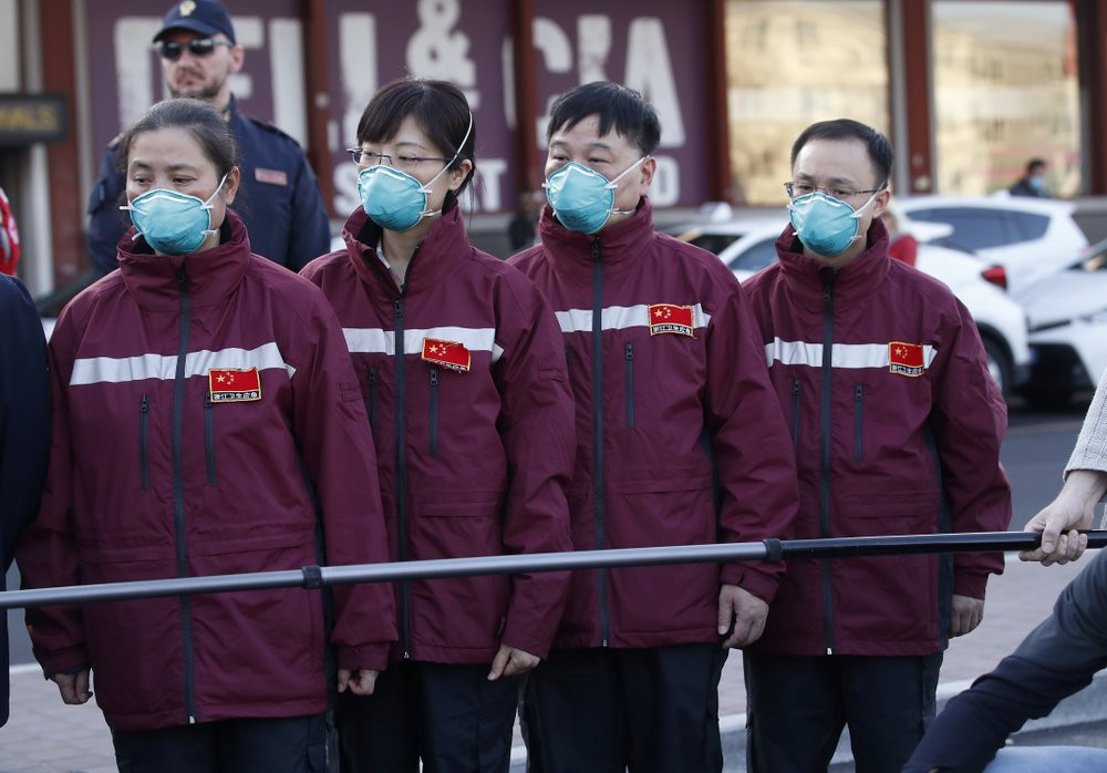 Medics and paramedics from China arrive at the Malpensa airport of Milan, Wednesday, March 18, 2020.