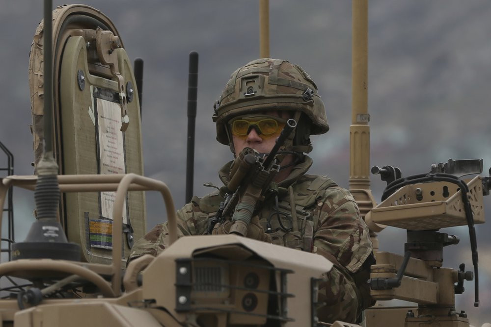 A British soldier with NATO-led Resolute Support Mission forces arrives at the site of an attack in Kabul, Afghanistan, Wednesday, March 25, 2020.