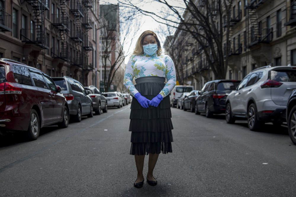 Tiffany Pinckney poses for a portrait in the Harlem neighborhood of New York on April 1, 2020. After a period of quarantine at home separated from her children, she has recovered from COVID-19.
