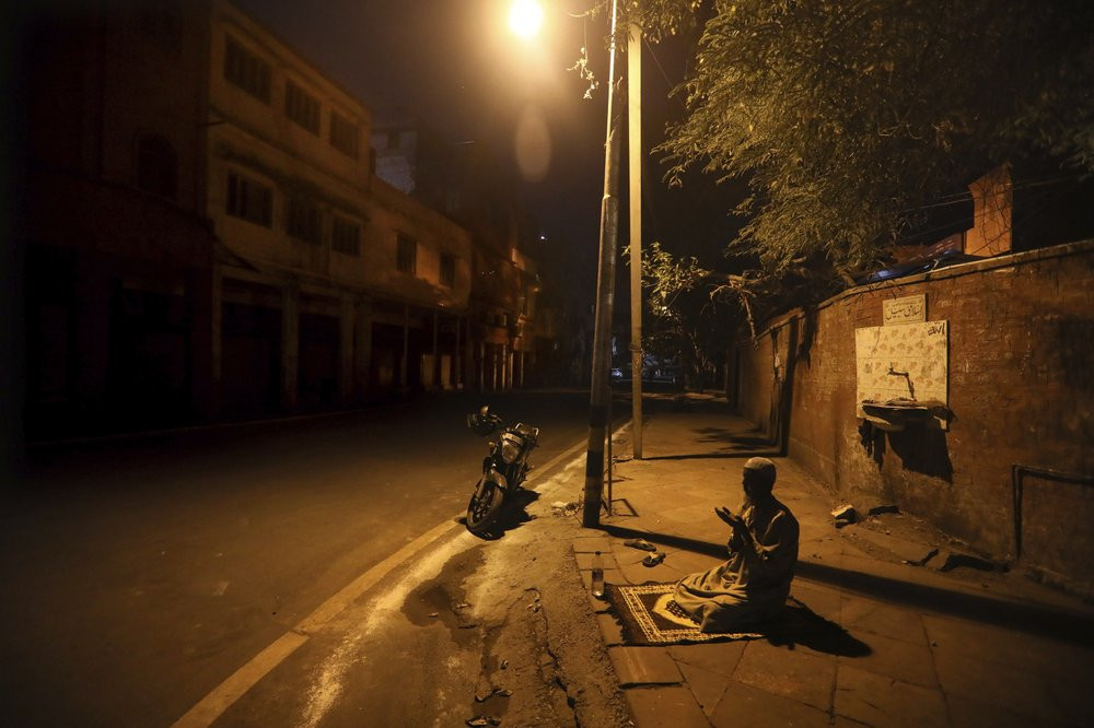 In this Saturday, April 25, 2020 file photo, a Muslim man prays on a street outside Jama Masjid on the first day of Ramadan during a nationwide lockdown to control the spread of coronavirus, in New Delhi, India.