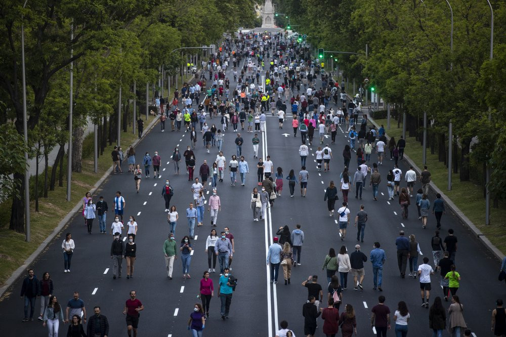 People exercise along Paseo de la Castellana after loosening of the lockdown measures imposed by the government due to coronavirus in Madrid, Spain, Saturday, May 9, 2020.