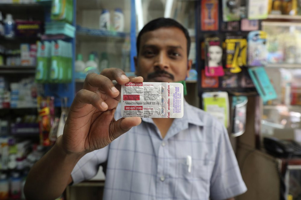 A chemist displays hydroxychloroquine tablets in Mumbai, India, Tuesday, May 19, 2020. President Donald Trump's declaration that he was taking the antimalarial drug of dubious effectiveness to help fend off the coronavirus will be welcomed in India.