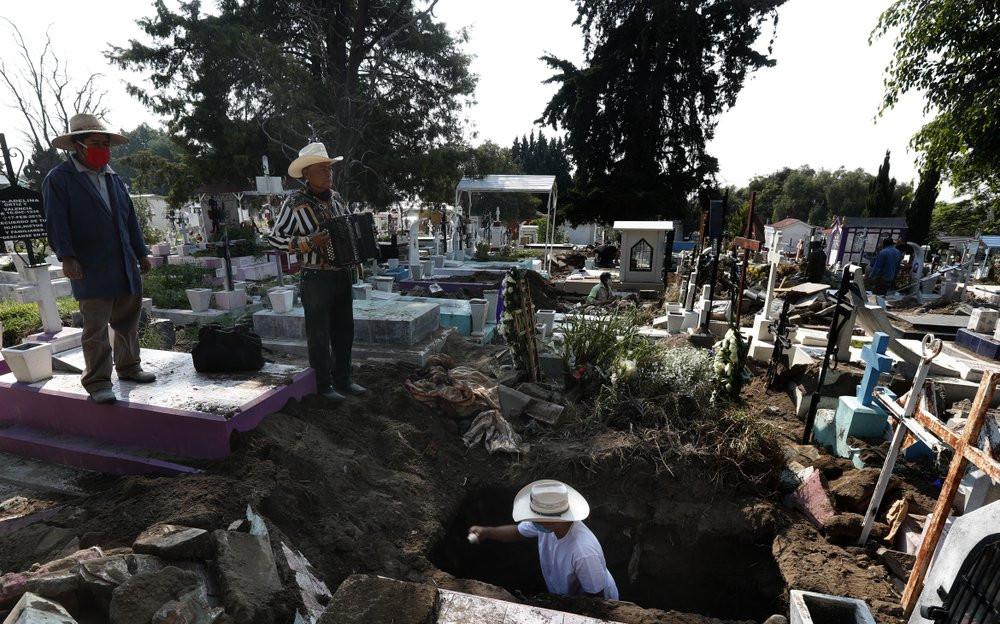 Cemetery musician Victor Dzib Cima, 70, plays his accordion as he waits for clients while cemetery workers remove coffins from gravesites that belonged to families who stopped paying rent at the San Nicolas Tolentino Pantheon in Mexico City.