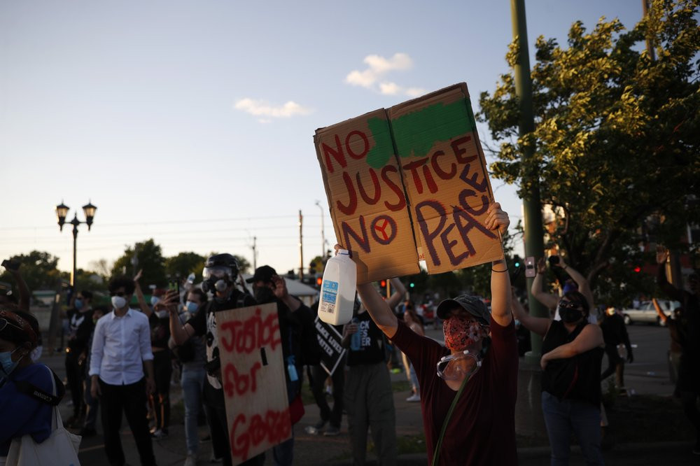 Demonstrators gather Thursday, May 28, 2020, in St. Paul, Minn. Protests over the death of George Floyd, the black man who died in police custody broke out in Minneapolis for a third straight night.