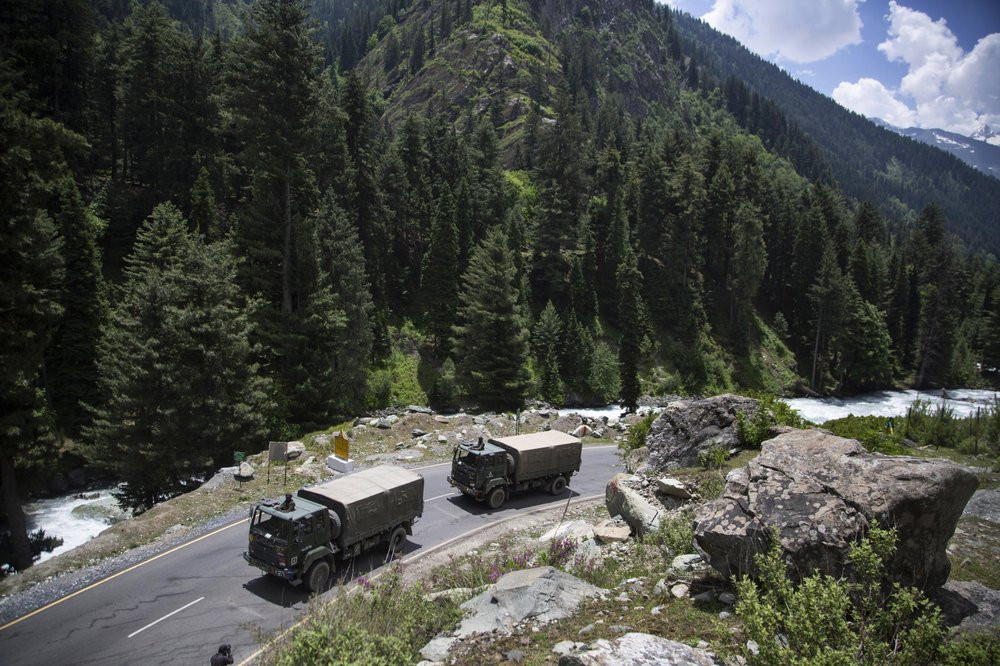 In this Tuesday, Sept. 1, 2020, file photo, an Indian army convoy moves on the Srinagar- Ladakh highway at Gagangeer, northeast of Srinagar, Indian-controlled Kashmir.