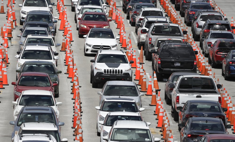 Lines of cars wait at a coronavirus testing site outside of Hard Rock Stadium, Friday, June 26, 2020, in Miami Gardens, Florida.