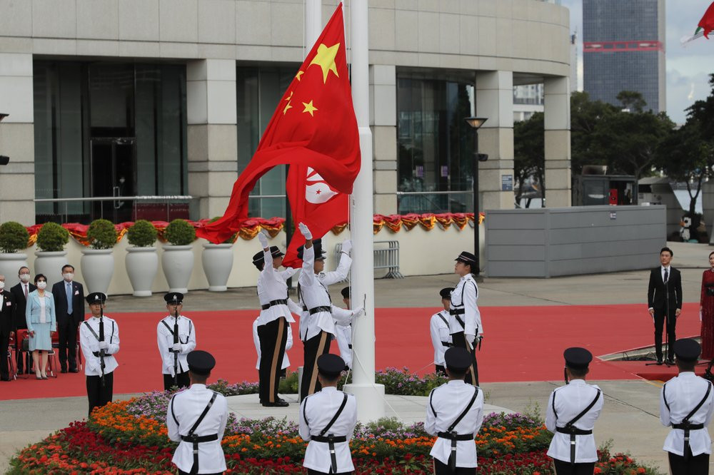 A flag raising ceremony is held at the Golden Bauhinia Square to mark the anniversary of the Hong Kong handover to China in Hong Kong, Wednesday, July 1, 2020.