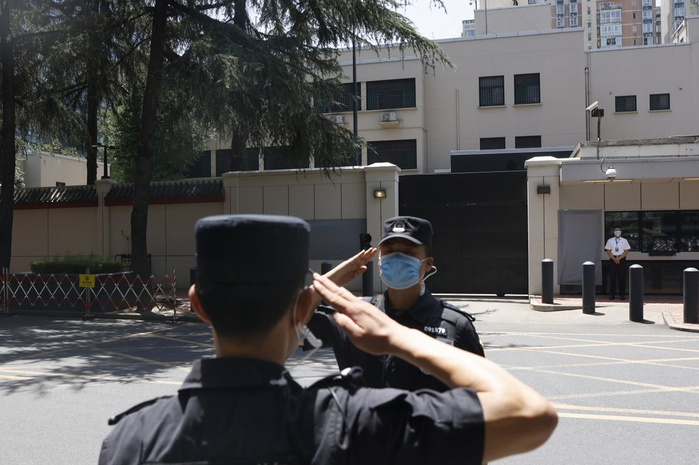 Chinese SWAT officers salute each other at the former United States Consulate in Chengdu in southwest China's Sichuan province on Monday, July 27, 2020 after Chinese authorities took control of the former consulate on Monday.