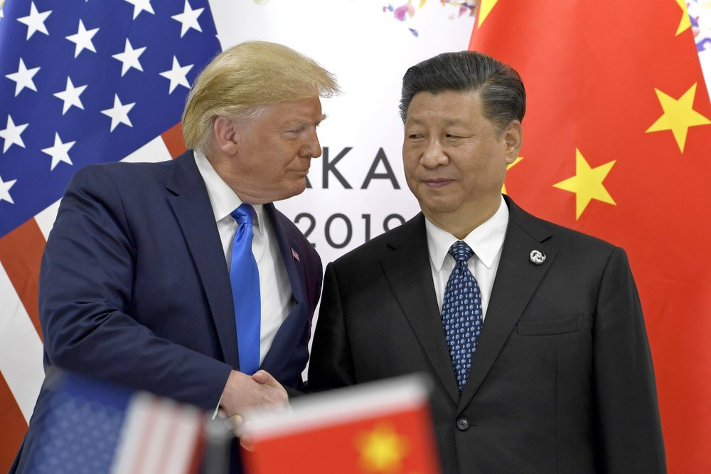 - In this June 29, 2019, file photo, U.S. President Donald Trump, left, shakes hands with Chinese President Xi Jinping during a meeting on the sidelines of the G-20 summit in Osaka, western Japan.