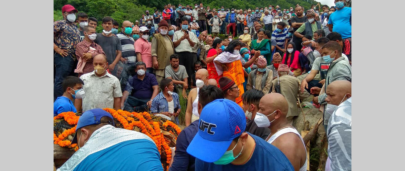 Families and locals attending cremation of Basnet. Photo Courtesy: Dipak Dulal