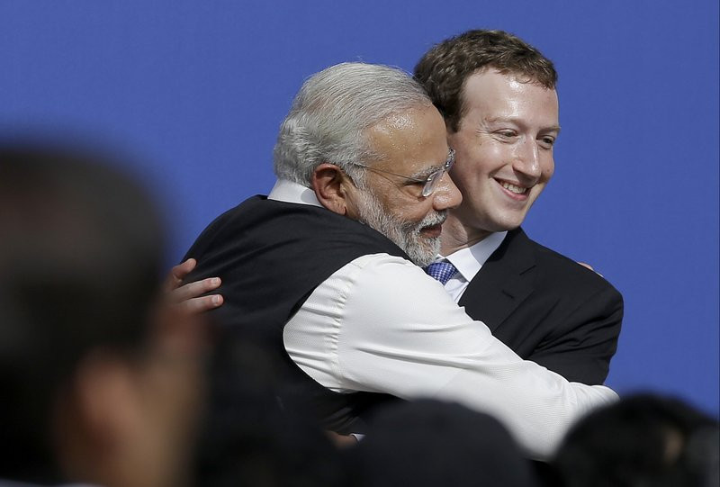 In this Sept. 27, 2015, file photo, Facebook CEO Mark Zuckerberg, right, hugs Prime Minister of India Narendra Modi at Facebook in Menlo Park, California.