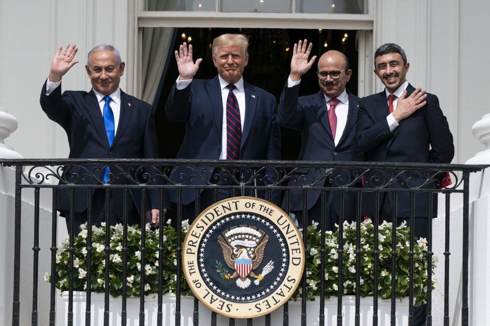 Israeli Prime Minister Benjamin Netanyahu, left, President Donald Trump, Bahrain Foreign Minister Khalid bin Ahmed Al Khalifa and United Arab Emirates Foreign Minister Abdullah bin Zayed al-Nahyan wave after signing the deal.