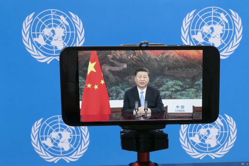 Chinese President Xi Jinping is seen on a video screen remotely addressing the 75th session of the United Nations General Assembly, Tuesday, Sept. 22, 2020, at U.N. headquarters.