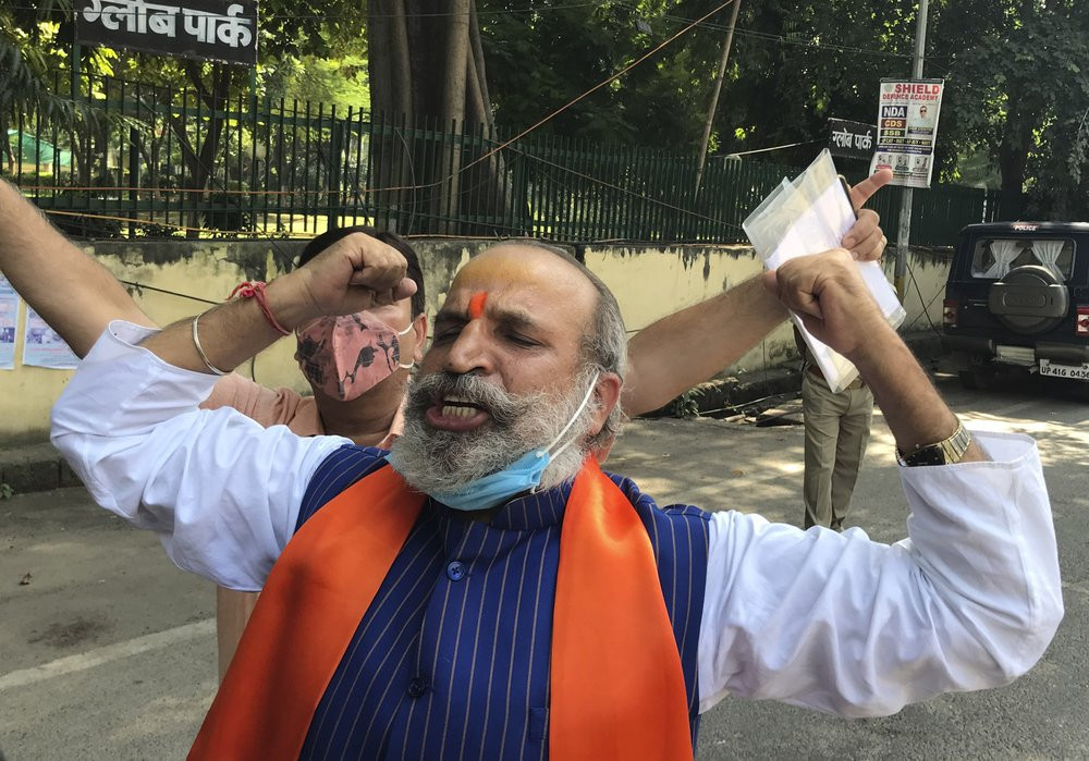 Jai Bhagwan Goyal, a leader of India's ruling Bharatiya Janata Party and an accused in the 1992 attack and demolition of a 16th century mosque, celebrates outside a court in Lucknow, India, Wednesday, Sept. 30, 2020.