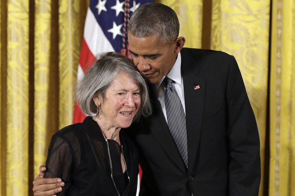 In this Thursday, Sept. 22, 2016 file photo, President Barack Obama embraces poet Louise Gluck before awarding her the 2015 National Humanities Medal during a ceremony in the East Room of the White House, in Washington.
