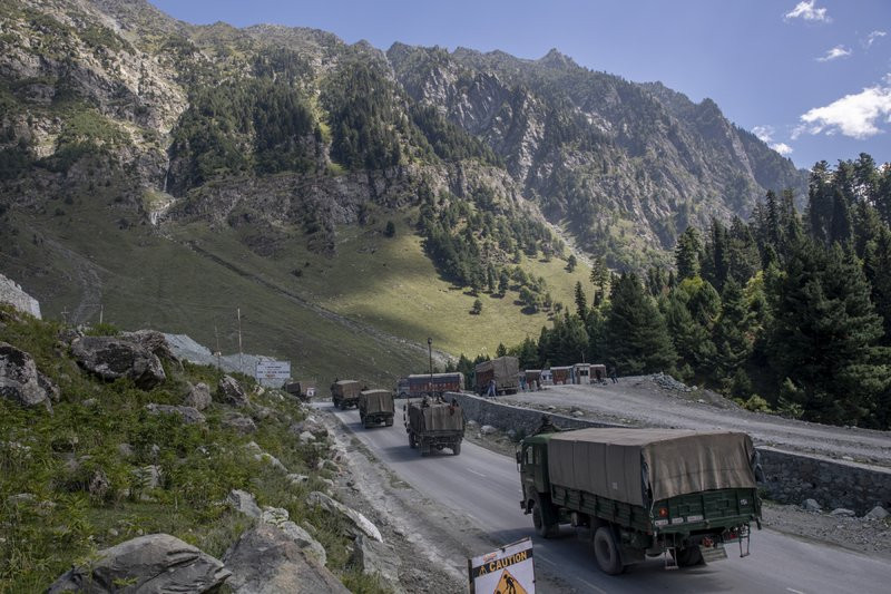 In this Sept. 9, 2020, file photo, an Indian army convoy moves on the Srinagar- Ladakh highway at Gagangeer, northeast of Srinagar, Indian-controlled Kashmir.