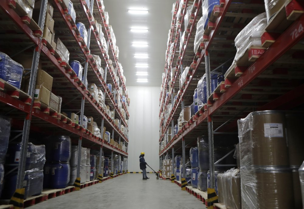 A worker moves boxes at Snowman Logistics, India's largest cold storage company in Taloja, on the outskirts of Mumbai, India, Saturday, Oct. 17, 2020.