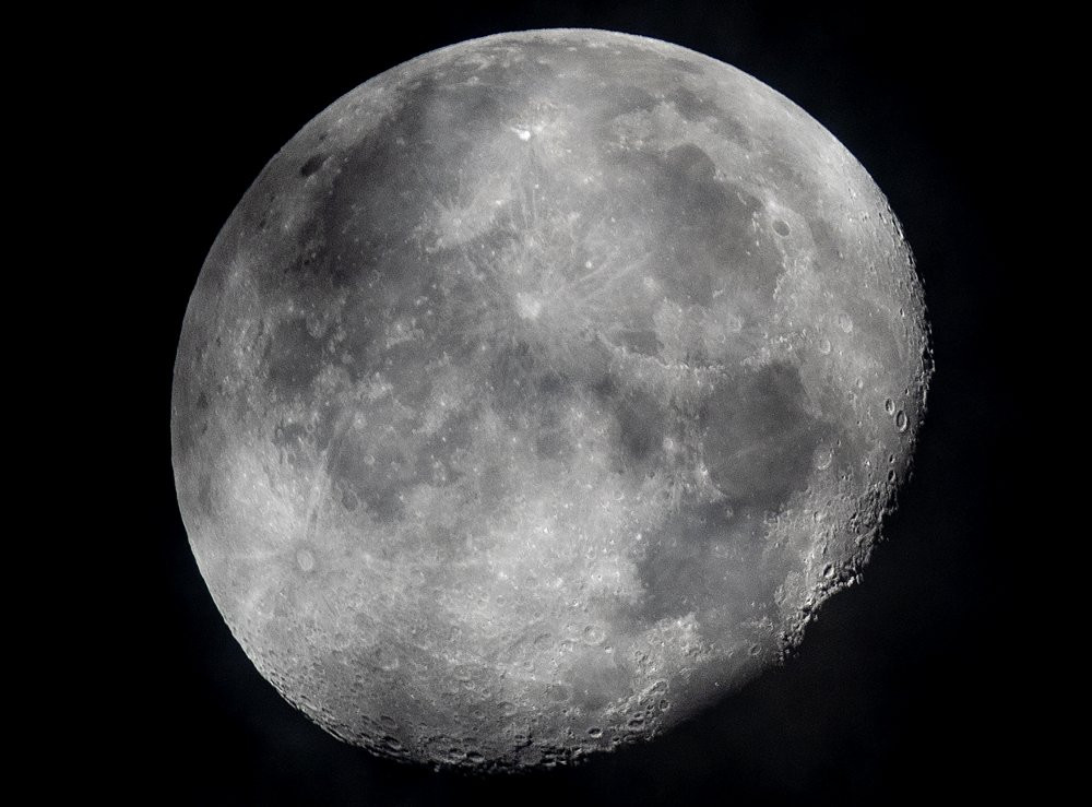 In this early Monday, Oct. 5, 2020, file photo, a waning moon is seen at the sky over Frankfurt, Germany.