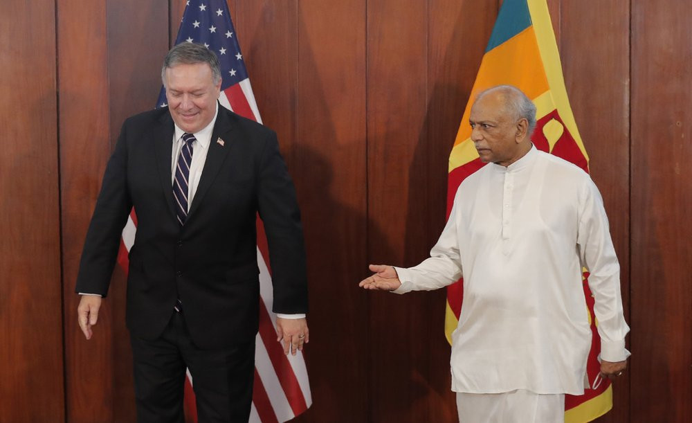 Sri Lankan Foreign Minister Dinesh Gunawardena gestures towards U.S. Secretary of State Mike Pompeo before their meeting in Colombo, Sri Lanka, Wednesday, Oct. 28, 2020.