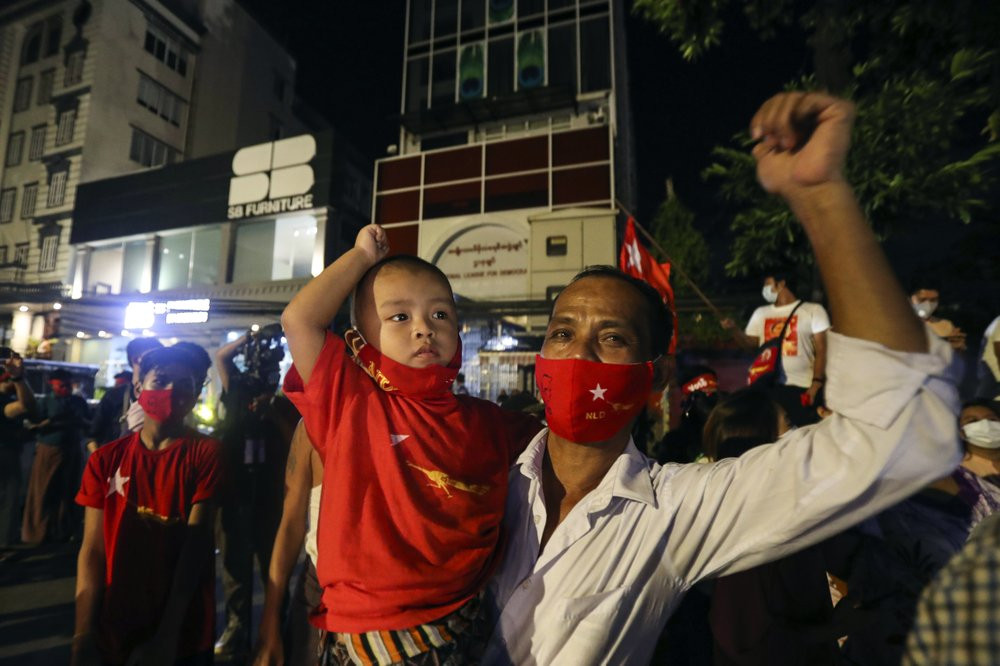 Supporters wearing face mask cheer as they gather in front of Myanmar Leader Aung San Suu Kyi's National League for Democracy (NLD) party's headquarters during Election Day Sunday, Nov. 8, 2020, in Yangon, Myanmar.
