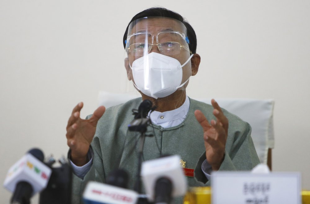 Myint Naing, a member of the Union Election Commission, wearing a protective face mask and shield, gestures as he delivers a speech during an event to announce election results Wednesday, Nov. 11, 2020, in Naypyitaw, Myanmar.