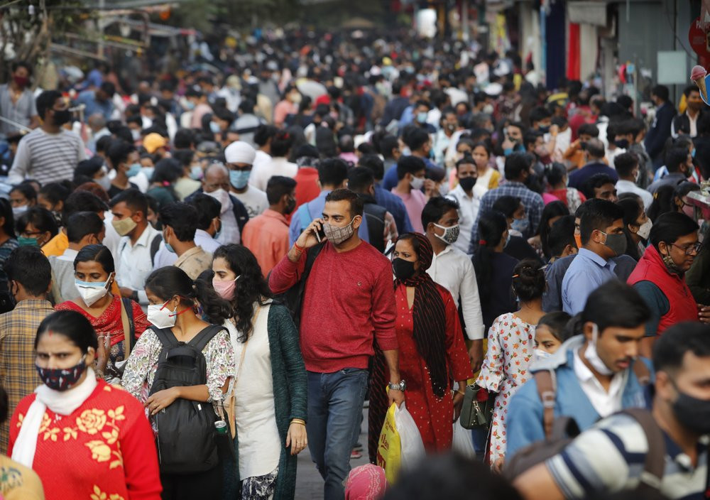 People throng a market to shop ahead of the Diwalli festival in New Delhi, India, Thursday, Nov. 12, 2020.
