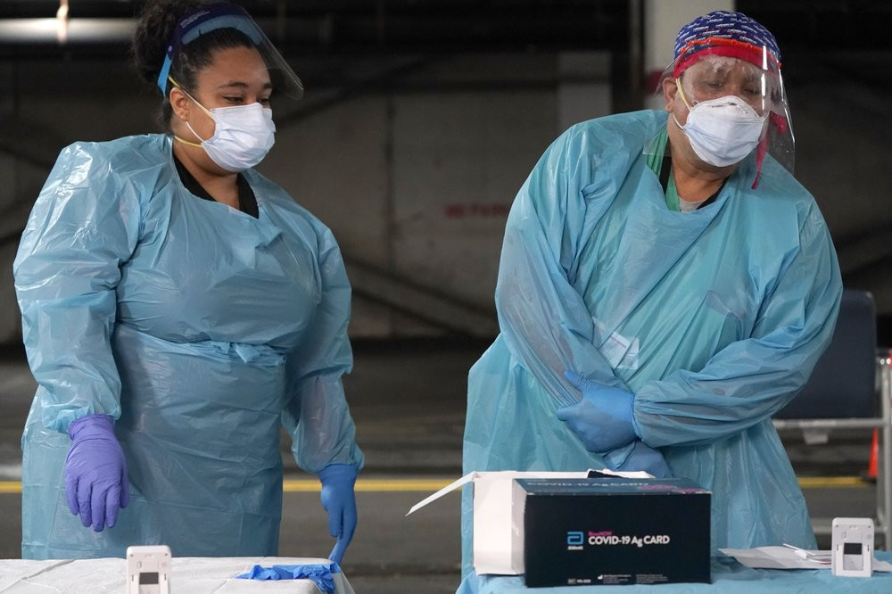 Nurses check on the status of rapid COVID-19 tests at a drive-through testing site in a parking garage in West Nyack, N.Y., Monday, Nov. 30, 2020.