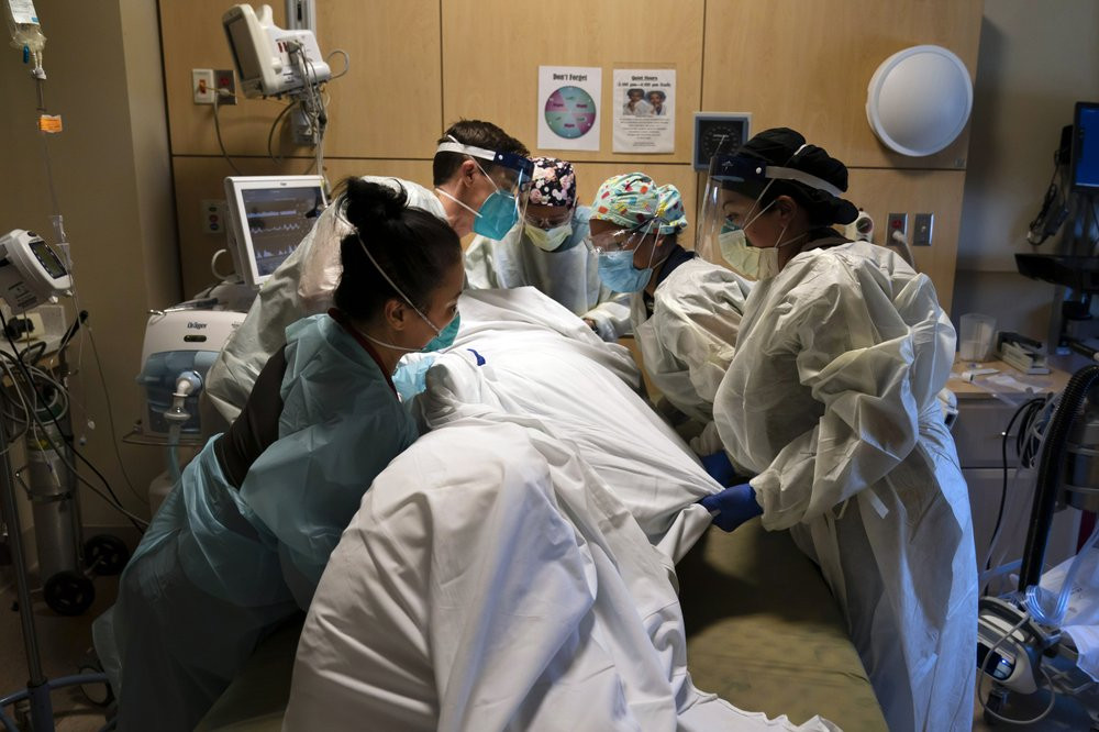 In this Nov. 19, 2020, file photo, medical personnel prone a COVID-19 patient at Providence Holy Cross Medical Center in the Mission Hills section of Los Angeles.