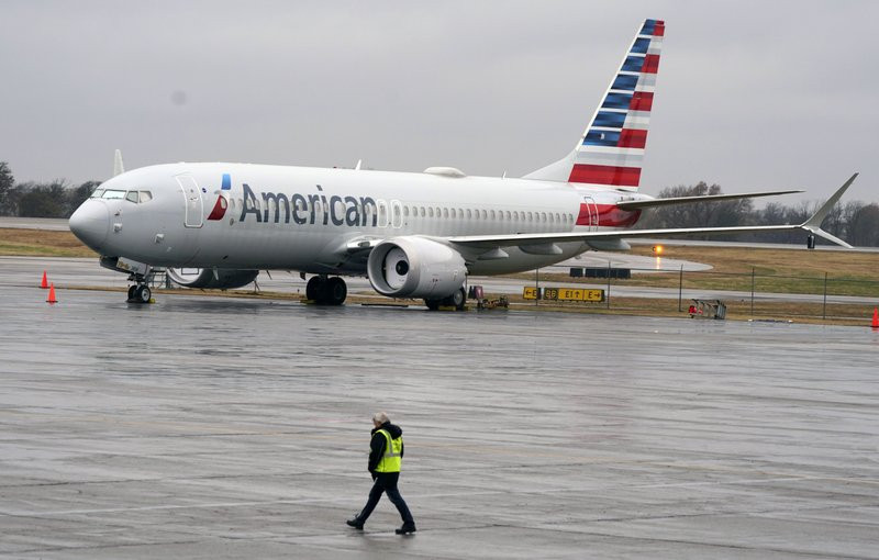 In this Dec. 2, 2020 file photo, an American Airlines Boeing 737 Max jet plane is parked at a maintenance facility in Tulsa, Oklahoma.