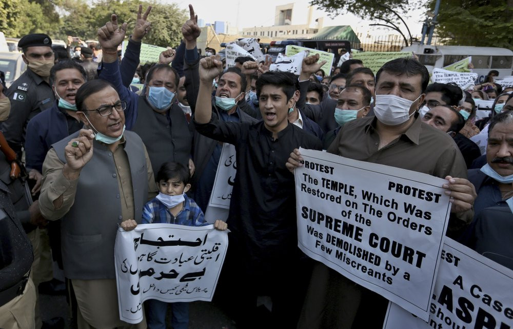 Members of Pakistan Hindu Council hold a protest against the attack on a Hindu temple in the northwestern town of Karak, in Karachi, Pakistan, Thursday, Dec. 31, 2020.