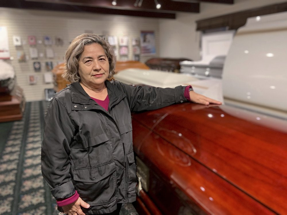 Magda Maldonado, owner of Continental Funeral Home in Los Angeles, poses in her mortuary on Dec. 30, 2020.