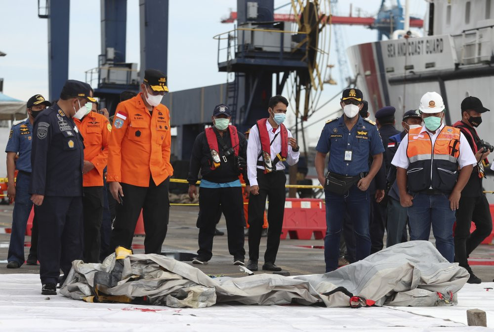 Rescuers inspect debris found in the waters around the location where a Sriwijaya Air passenger jet has lost contact with air traffic controllers shortly after the takeoff, at the search and rescue command center at Tanjung Priok Port on Sunday.