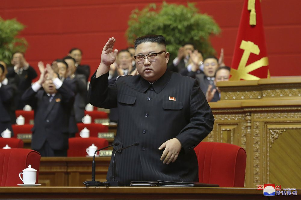 In this photo provided by the North Korean government, North Korean leader Kim Jong Un acknowledges to the applauds after he made his closing remarks at a ruling party congress in Pyongyang, North Korea Tuesday, Jan. 12, 2021.