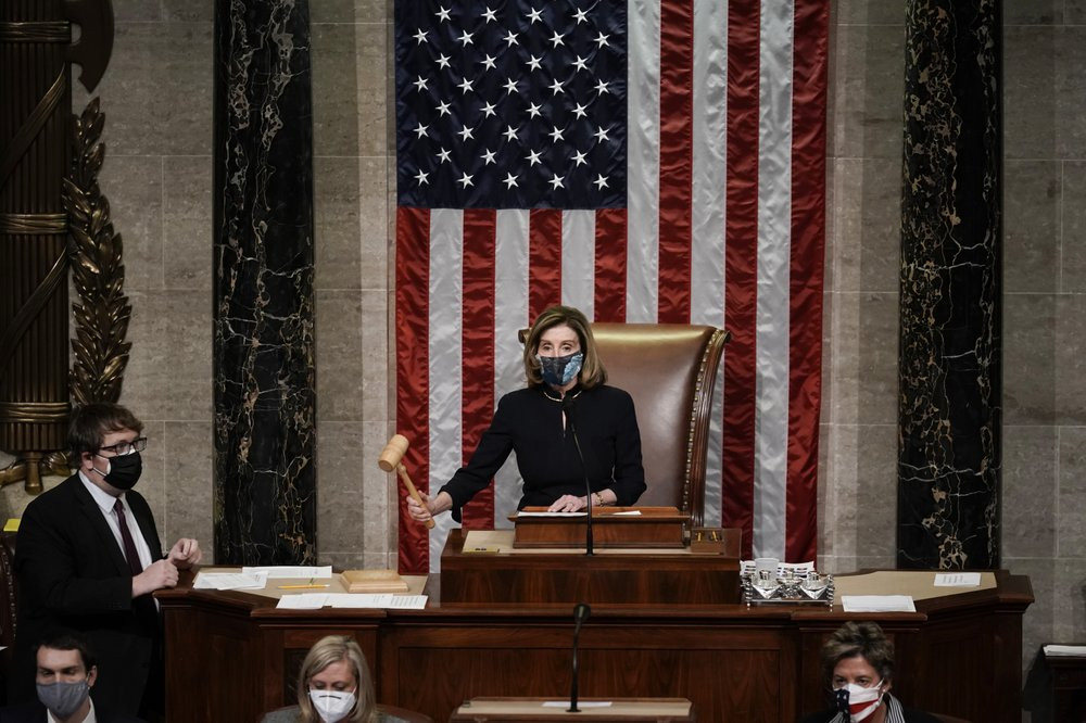 Speaker of the House Nancy Pelosi, D-Calif., leads the final vote of the impeachment of President Donald Trump, for his role in inciting an angry mob to storm the Congress last week, at the Capitol in Washington, Wednesday.