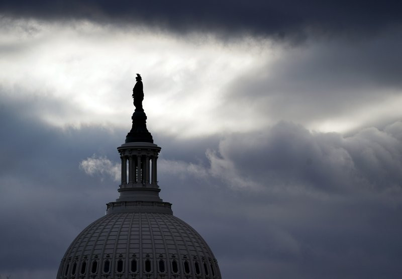 The Statue of Freedom by Thomas Crawford, atop the dome of the U.S. Capitol, is shown ahead of the inauguration of President-elect Joe Biden and Vice President-elect Kamala Harris, Sunday, Jan. 17, 2021, in Washington.