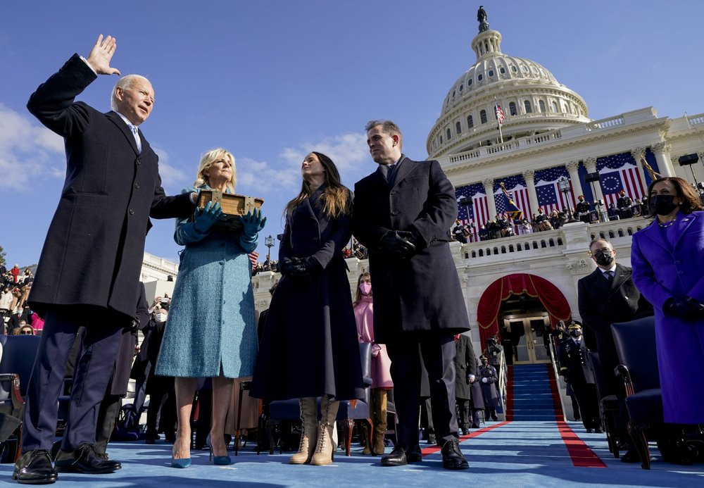 Joe Biden is sworn in as the 46th president of the United States by Chief Justice John Roberts as Jill Biden holds the Bible during the 59th Presidential Inauguration at the U.S. Capitol in Washington, Wednesday.