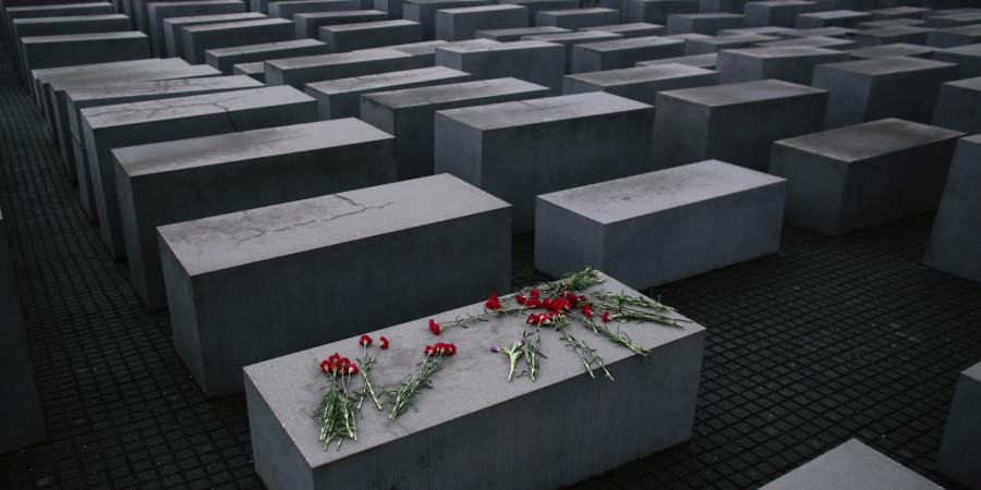 In this January 27, 2015 file photo, flowers lay on a concrete slab of the Holocaust Memorial.